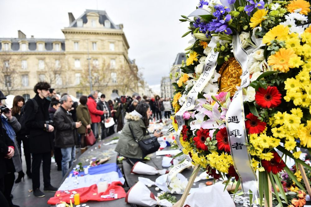 People take part in a gathering at a makeshift memorial for the victims of the attacks claimed by Islamic State, on November 16, 2015 at the Place de la Republique in Paris. France and other countries in Europe held a minute's silence in memory of the victims of the worst ever terror attacks on French soil. (Loic Venance/AFP/Getty Images)