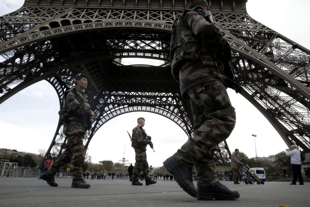 Soldiers patrol at the foot of the Eiffel Tower in Paris on November 16, 2015 three days after the terrorist attacks that left at least 129 dead and more than 350 injured. France prepared to fall silent at noon on November 16 to mourn victims of the Paris attacks after its warplanes pounded the Syrian stronghold of Islamic State, the jihadist group that has claimed responsibility for the slaughter. (Kenzo Tribouillard/AFP/Getty Images)