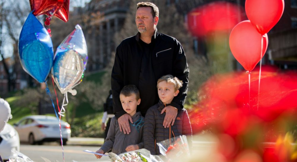 In this photo, James Jones of Woodbridge, Va., brings his two sons Riley, 7, and Grayson, 5, to a memorial outside the gates of the French Embassy in Washington, Sunday, Nov. 15, 2015. The Islamic State group claimed responsibility for Friday's attacks on a stadium, a concert hall and Paris cafes that left more than 120 people dead and over 350 wounded. (Andrew Harnik/ AP)