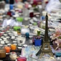 A miniature Eiffel tower, candles and flowers are seen at a makeshift memorial outside Le Carillon café at the corner of Rue Bichat and Alibert in the 10th arrondissement and Le petit Cambodge restaurant at the site of the attacks in Paris, on November 17, 2015 in tribute to the victims of the attacks claimed by Islamic State, which killed at least 129 people and left more than 350 injured on November 13. (Kenzo Tribouillard/AFP/Getty Images)