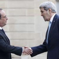 French President François Hollande (left) welcomes U.S. Secretary of State John Kerry prior to a meeting at the Élysée Presidential Palace on November 17, 2015 in Paris, France. (Thierry Chesnot/Getty Images)
