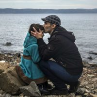 "Eileen McNamara: ""If they are not the embodiment of the promise engraved on the Statue of Liberty, who exactly are the 'huddled masses yearning to breathe free' that Emma Lazarus described?"" In this photo, a Syrian man kisses his daughter shortly after disembarking from a dinghy at a beach on the Greek island of Lesbos, Monday, Nov. 16, 2015. (Santi Palacios/AP)"