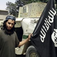 This undated image made available in the Islamic State's English-language magazine Dabiq, shows Belgian Abdelhamid Abaaoud. The Belgian jihadi suspected of masterminding deadly attacks in Paris was killed in a police raid on a suburban apartment building, the city prosecutor's office announced Thursday Nov. 1, 2015. Paris Prosecutor Francois Molins' office said 27-year-old Abdelhamid Abaaoud was identified based on skin samples. His body was found in the apartment building targeted in the chaotic and bloody raid in the Paris suburb of Saint-Denis on Wednesday. (Militant photo via AP)