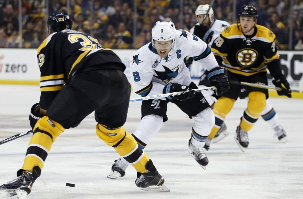 San Jose Sharks' Joe Pavelski (8) brings the puck up as Boston Bruins' Zdeno Chara (33) defends during the game last night in Boston. The Bruins lost, 5-4. (Michael Dwyer/AP)