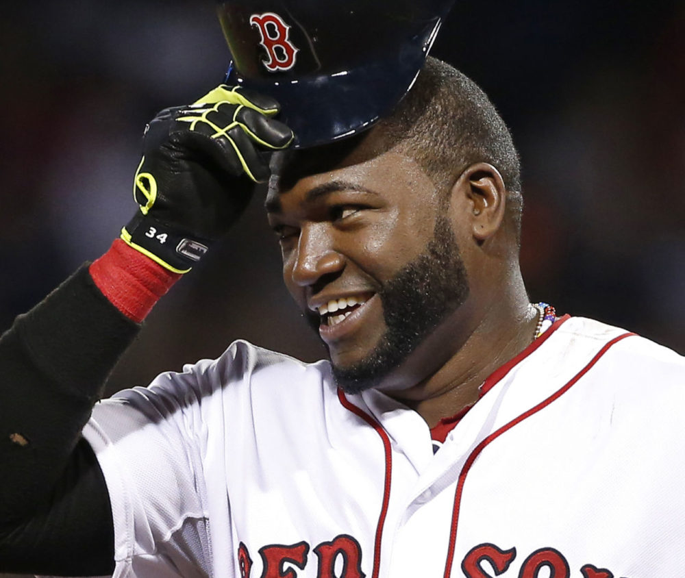 Boston Red Sox designated hitter David Ortiz tips his cap during a game at Fenway Park in Boston in 2014. Big Papi announced he will retire after next season. (Elise Amendola/AP)
