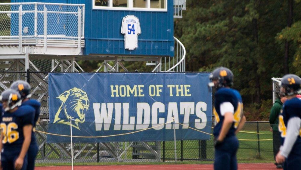 The Shoreham Wading River High School football team takes the field in Wading River, N.Y., on October 11, against Wyandanch in their first game since their teammate Tom Cutinella died on the field the week before. (Andrew Theodorakis/Getty Images)