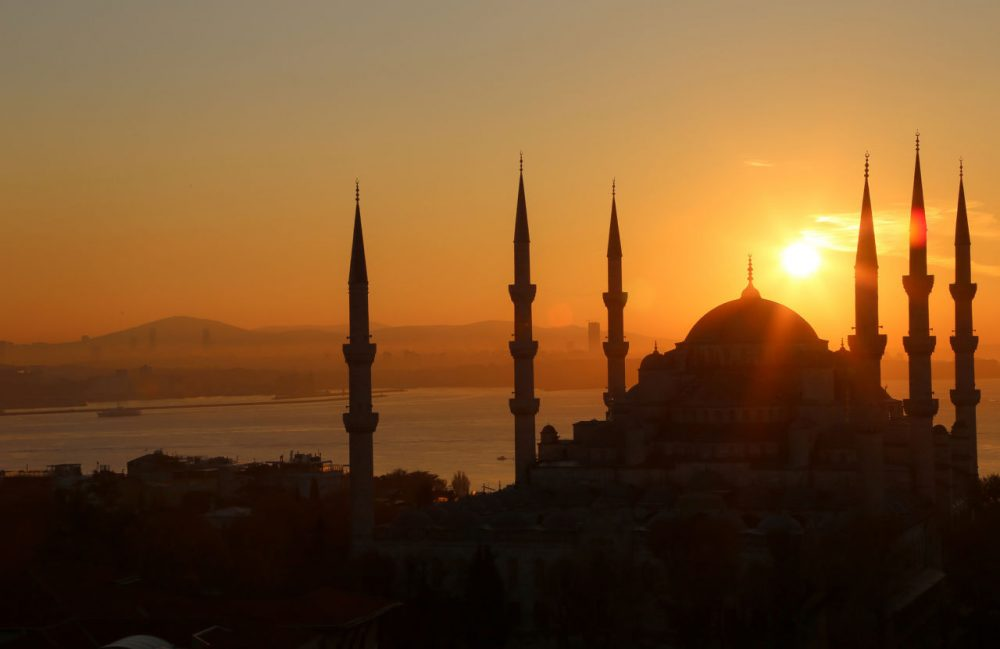 The sun rises over the Sultan Ahmed Mosque, known popularly as the Blue Mosque, in Istanbul. (ynakanishi/Flickr)