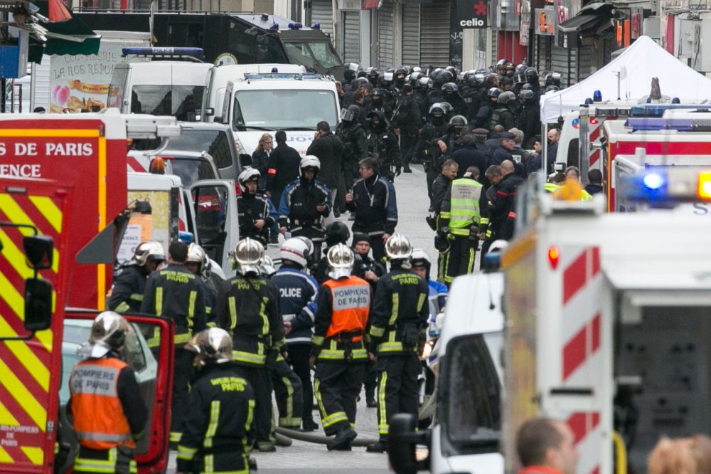 French special forces and medical vehicles are seen on Rue de la Republique on November 18, 2015 in Saint-Denis, France. French police special forces raided an apartment, hunting those behind the attacks that claimed 129 lives in the French capital five days ago. At least one person was killed in an apartment targeted during the operation aimed at the suspected mastermind of the attacks, Belgian Abdelhamid Abaaoud. At least five police officers have been wounded in the shootout. (Marc Piasecki/Getty Images)