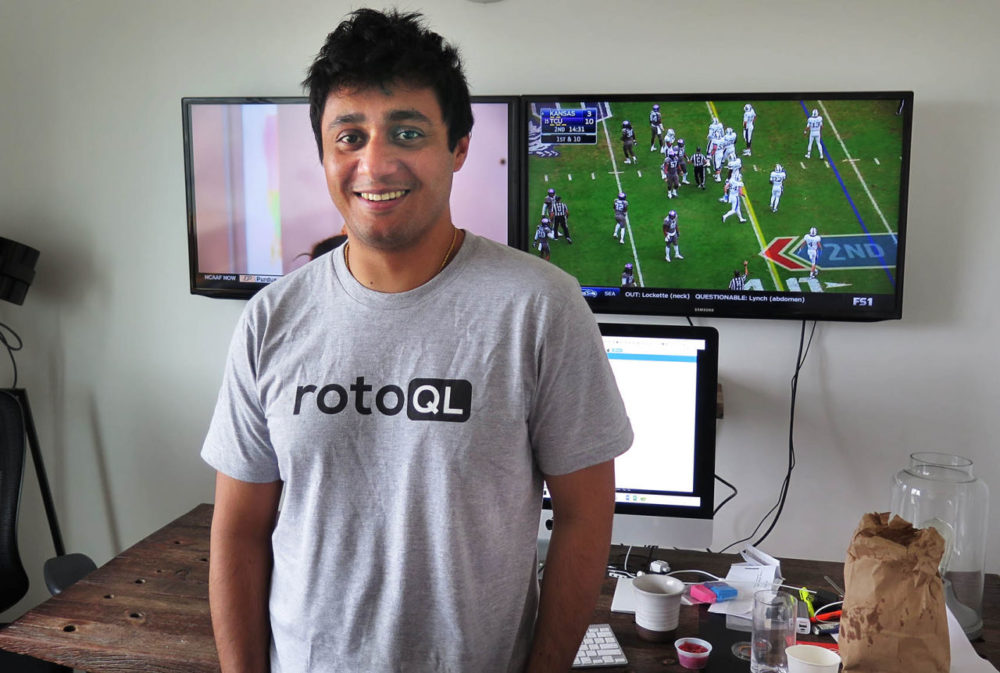 Saahil Sud stands in his apartment in downtown Boston before getting back to work at his full-time job playing daily fantasy sports. (Curt Nickisch/WBUR)