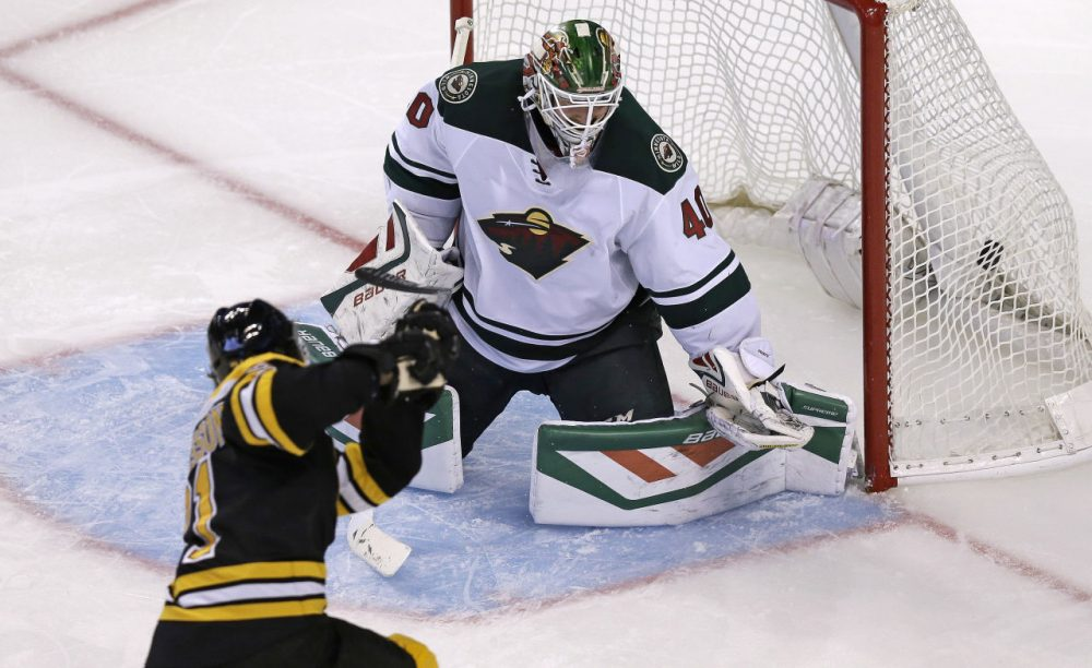 Boston Bruins left wing Loui Eriksson shoots his third goal of the game past Minnesota Wild goalie Devan Dubnyk (40). It was Eriksson's third career hat trick. (Charles Krupa/AP)
