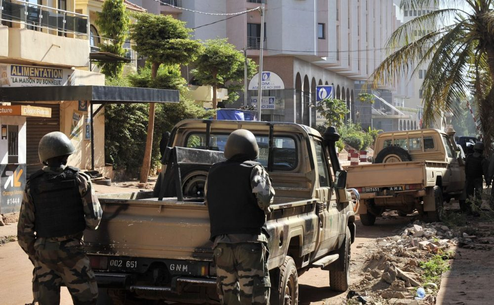 Malian troops take position outside the Radisson Blu hotel in Bamako on November 20, 2015. Gunmen went on a shooting rampage at the luxury hotel in Mali's capital Bamako, seizing 170 guests and staff in an ongoing hostage-taking that has left at least three people dead. (Habibou Kouyate/AFP/Getty Images)