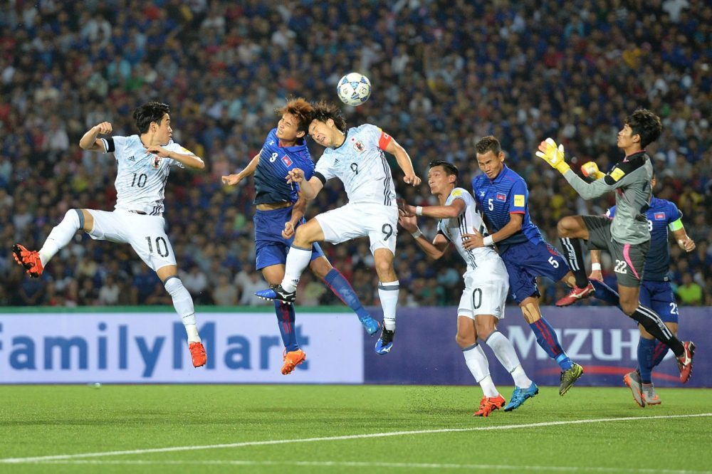 PHNOM PENH, CAMBODIA - NOVEMBER 17: Shinji Okazaki #9 of Japan heads the ball during the 2018 FIFA World Cup Qualifier match between Cambodia and Japan on November 17, 2015 in Phnom Penh, Cambodia.  (Photo by Thananuwat Srirasant/Getty Images)