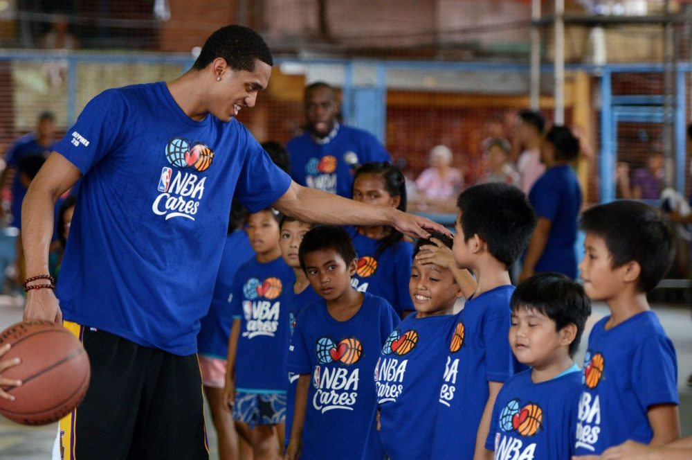 Programs like NBA Cares can make a difference, but experts say the real difference is made by coaches and mentors who work with the same kids over long periods of time.  (NOEL CELIS/AFP/Getty Images)