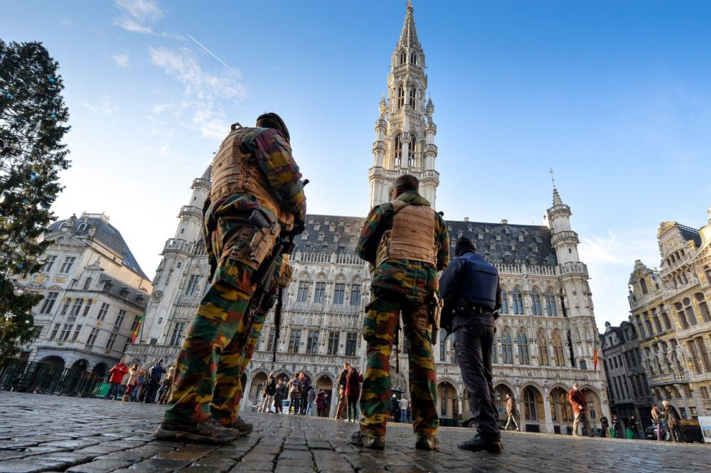 Soldiers and police patrol on Brussels' Grand Place as the Belgian capital remains on the highest possible alert level on November 23, 2015. Belgian police arrested five more people in a new series of anti-terrorism raids Monday, prosecutors said, as the capital Brussels was locked down for a third day under a state of maximum alert. (Dirk Waem/AFP/Getty Images)