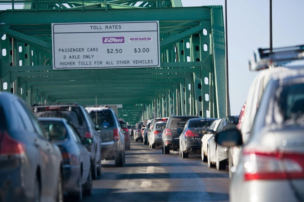 A new report is calling for improvements to Massachusetts public transportation systems to allow residents to cut down on driving miles, which the report says will save the state and its residents money. (Jesse Costa/WBUR)