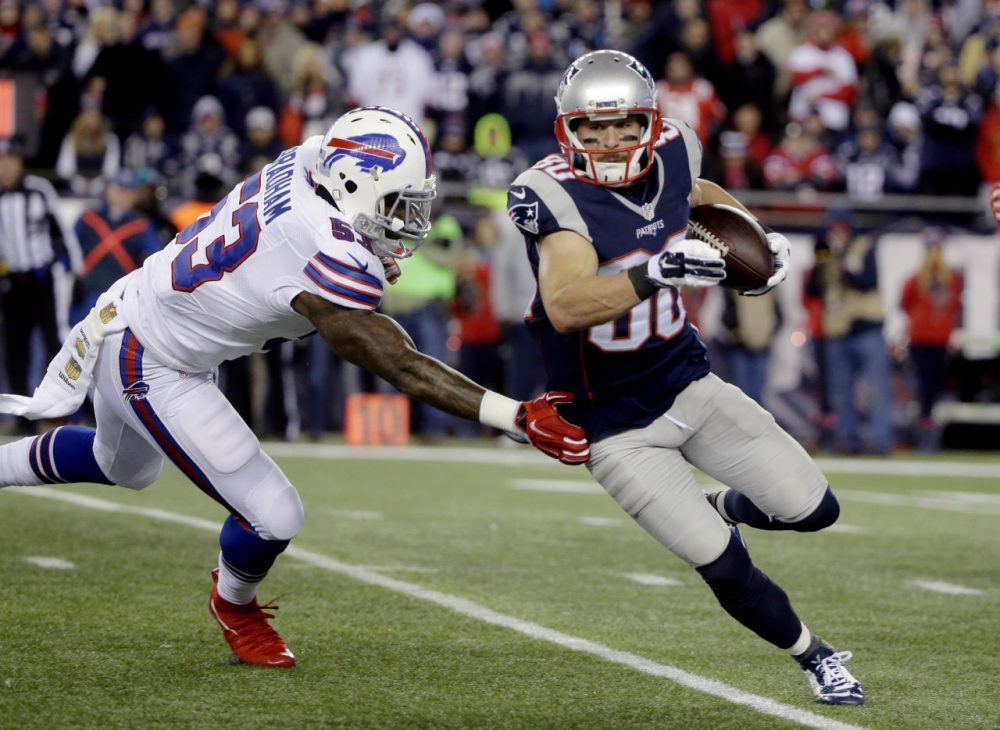 New England Patriots wide receiver Danny Amendola (80) runs from Buffalo Bills linebacker Nigel Bradham (53) after catching a pass in the game last night in Foxborough. The Patriots won 20-13. (Steven Senne/AP)