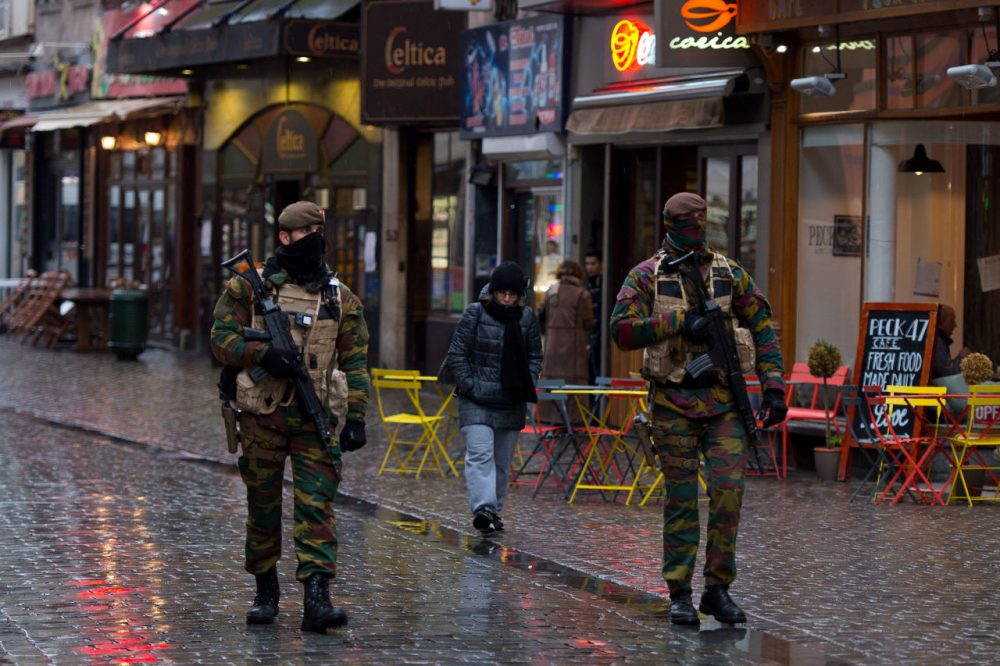 Armed policemen patrol along Rue Du Marche Aux Poulets on November 24, 2015 in Brussels, Belgium. At a press conference last night the Belgian Prime Minister Charles Michel announced that the city would remain at terror alert level four which is the countries highest threat level. The Prime Minister also announced that the public transport system and schools would re-open Wednesday.  (Ben Pruchnie/Getty Images)