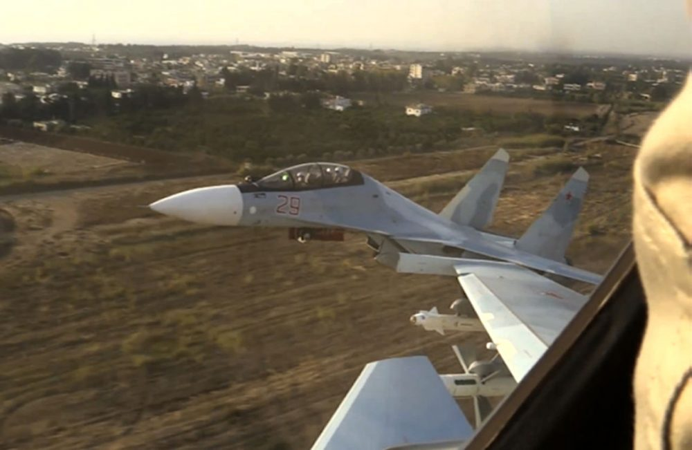In this photo made from video made available by Russian Defense Ministry official website on Friday, Nov. 20, 2015, Russian air force Su-30 fighter jets take off from the Hemeimeem air base in Syria as part of a Russian air campaign against target in Syria, according to information provided by Russian Defense Ministry. Russian long-range bombers and navy ships have launched 101 cruise missiles in four days, including 18 fired by Russian navy ships from the Caspian Sea on Friday, according to information released by Russian Defense Ministry. (Russian Defense Ministry Press Service/AP)