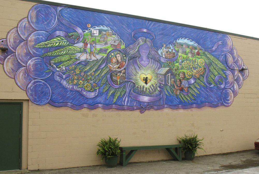 A mural covers the wall of a store in Rutland, Vt., commemorating the life of 17-year-old Carly Ferro, who was hit by a car and killed. Police said the driver was huffing from an aerosol can to intoxicate himself moments before the crash. Local officials said Ferro's 2012 death was the city's low point in its fight against heroin. (Wilson Ring/AP)