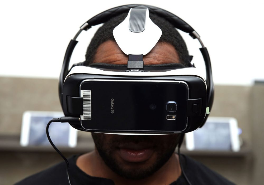 """A man tries out the 360-degree """"The Hunger Games - Virtual Reality Experience,"""" using the Samsung Gear VR, October 8, 2015 in New York City.  (Neilson Barnard/Getty Images for Samsung)"""