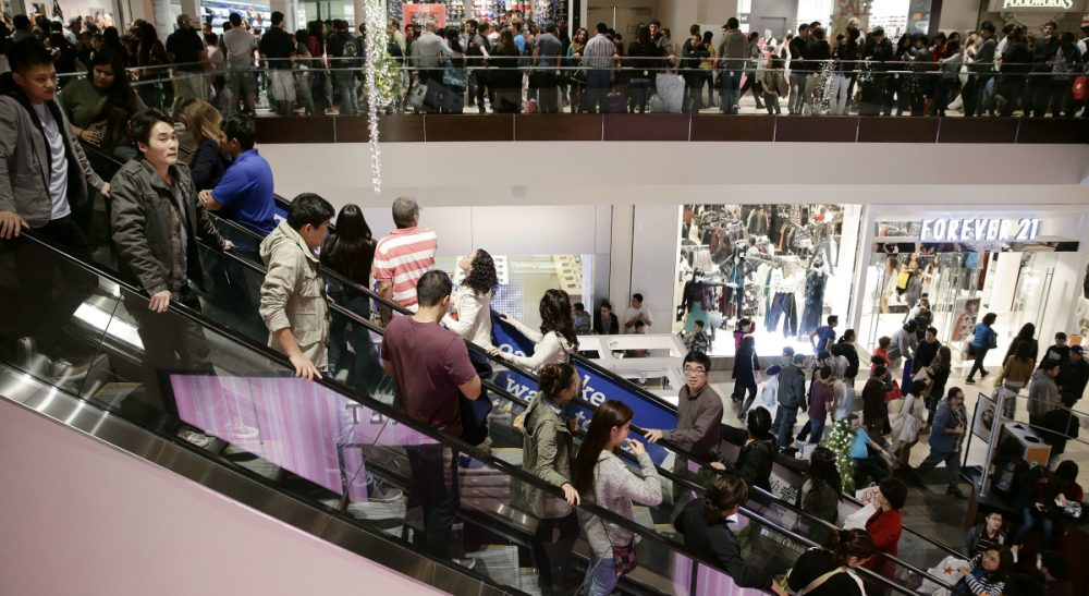 Mere hours after giving thanks, Black Friday beckons us to cast aside our gratitude in favor of a greedy lust for more, more, more. In this photo, shoppers throng Brea Mall during Black Friday shopping on Friday, Nov. 29, 2013, in Brea, Calif. (Jae C. Hong/ AP)