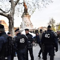 French gendarmes stand guard as dozens of people begin to gather for a demonstration in support of migrants at Place de la Republique (Republic Square) in Paris amid a ban on public gatherings on November 22, 2015. Paris has extended a ban on public gatherings introduced after the terror attacks in the French capital until November 30, the start of UN climate talks, the city's police headquarters said on November 21. (Loic Venance/AFP/Getty Images)