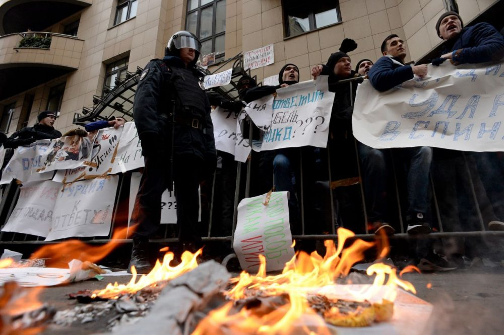 "Protesters hold placards and shout slogans as they take part in an anti-Turkey picket outside the Turkish embassy in Moscow on November 25, 2015. Turkey shot down a Russian war plane on the Syrian border on November 24, sending tensions spiraling as Russian President Vladimir Putin warned Ankara its ""stab in the back"" would have serious consequences. (Kirill Kudryavtsev/AFP/Getty Images)"