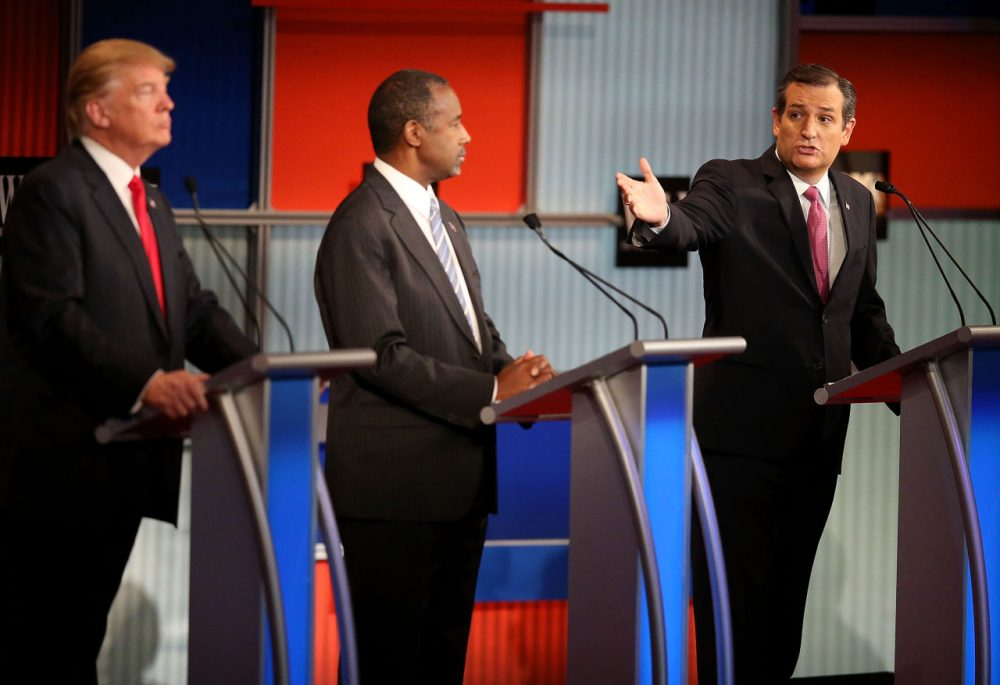 Republican presidential candidate Donald Trump (left) and Ben Carson (center) look on as U.S. Sen. Ted Cruz (R-TX) speaks during the Republican Presidential Debate sponsored by Fox Business and the Wall Street Journal at the Milwaukee Theatre on November 10, 2015, in Milwaukee, Wisconsin. (Scott Olson/Getty Images)