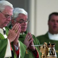 Cardinal Bernard Law, left, celebrates mass at the Cathedral of the Holy Cross in Boston Sunday, July 21, 2002. Law resigned in disgrace as archbishop of Boston over his role in the clergy sex abuse crisis. (John Bohn/ AP)