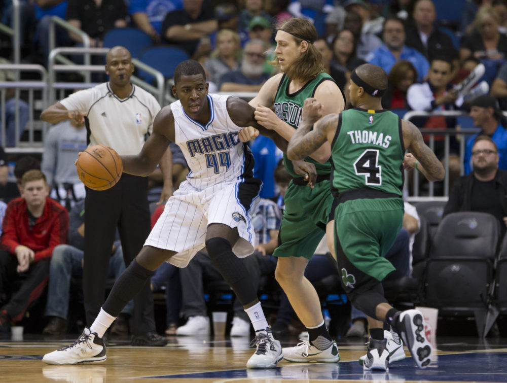 Orlando Magic forward Andrew Nicholson (44) drives the baseline against Boston Celtics center Kelly Olynyk (41) during the second half of an NBA basketball game on Sunday in Orlando, Fla. Orlando won, 110-91. (Scott Audette/AP)