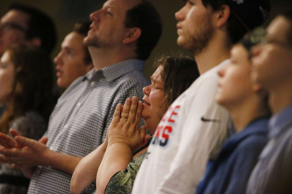 Members of Hope Chapel take part in service early Sunday, Nov. 29, 2015, in northeast Colorado Springs, Colo. University of Colorado-Colorado Springs police officer Garrett Swasey, who was one of the three victims of a shooting at a nearby Planned Parenthood clinic Friday, was a member of the congregation. (David Zalubowski/AP)