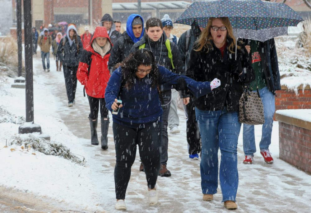 A student on the campus of the University of Nebraska at Omaha encounters a slippery pathway, in Omaha, Neb., Monday, Nov. 30, 2015. A slow-moving wintry storm system has been moving through parts of the Plains and the Midwest since Thursday. (Nati Harnik/AP)