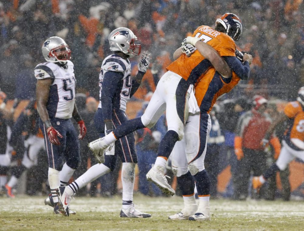 Denver Broncos quarterback Brock Osweiler (17) celebrates his touchdown pass against the New England Patriots during the second half of an NFL football game on Sunday in Denver. (Joe Mahoney/AP)