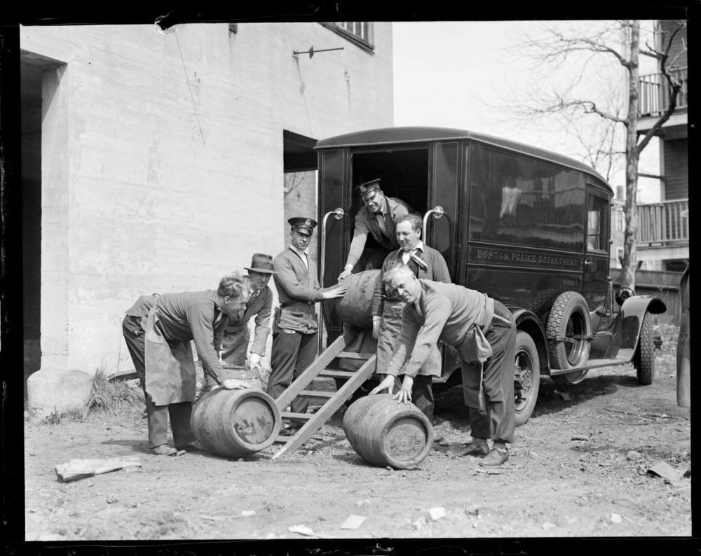 Police from Boston's Division 9 with casks seized during Prohibition, circa 1930. (Boston Public Library/flickr)