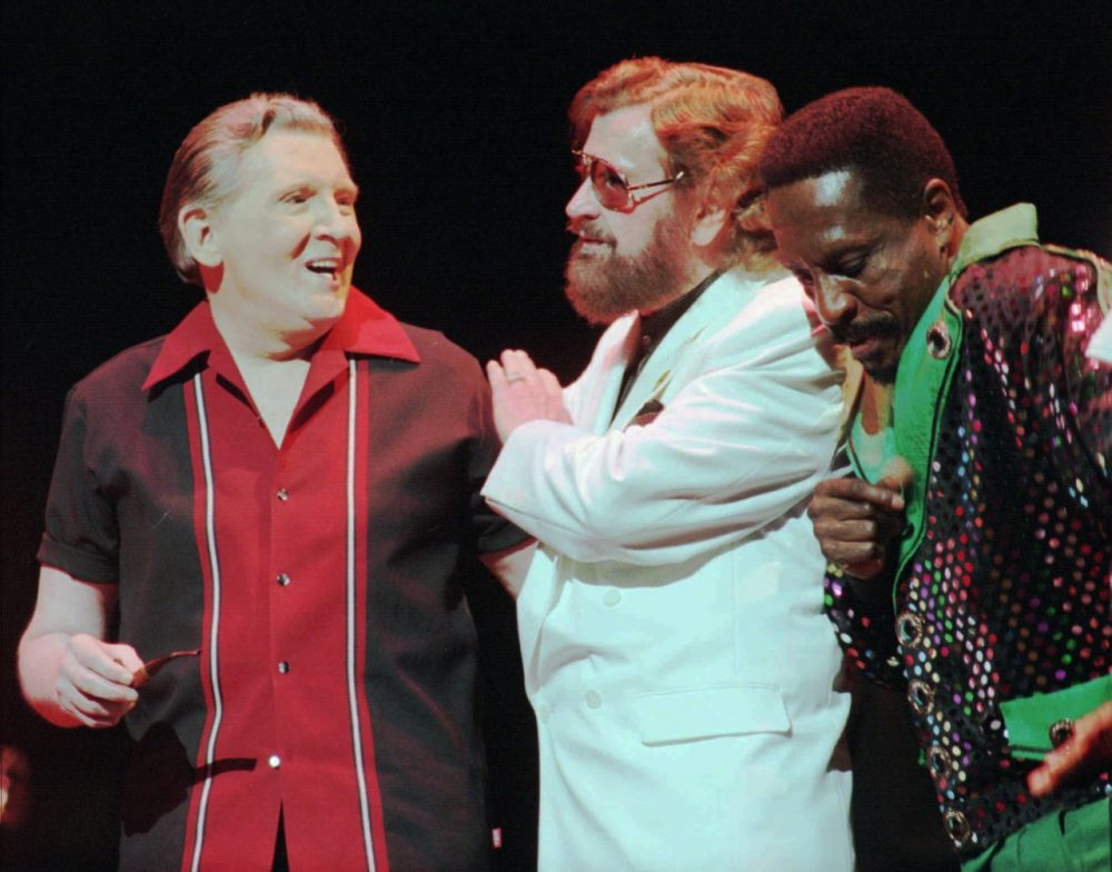 Rock 'n' roll recording pioneer Sam Phillips, center, chats with Jerry Lee Lewis, left, and Ike Turner at a party debuting Phillips' documentary in 2000. (AP/John L. Focht)