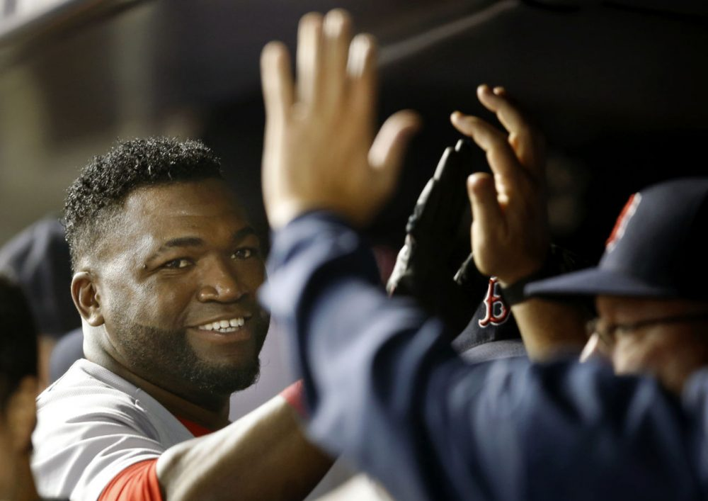 Red Sox's David Ortiz, left, greets teammates in the dugout in September 2015.  (Kathy Willens/AP)