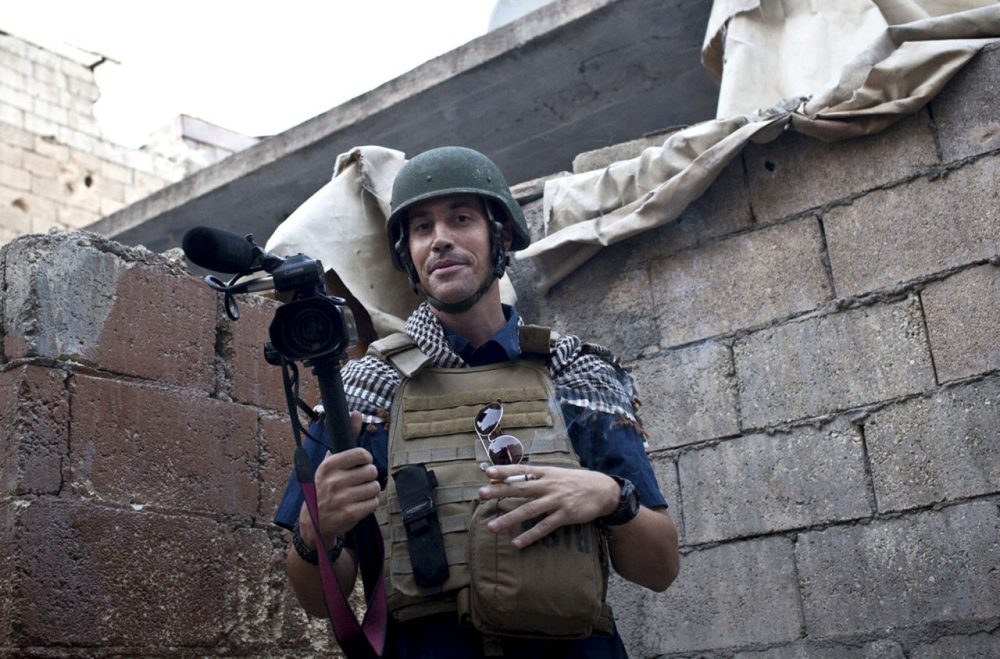 This November 2012 photo shows New Hampshire journalist James Foley covering the civil war in Aleppo, Syria. (freejamesfoley.org/Nicole Tung/AP File)