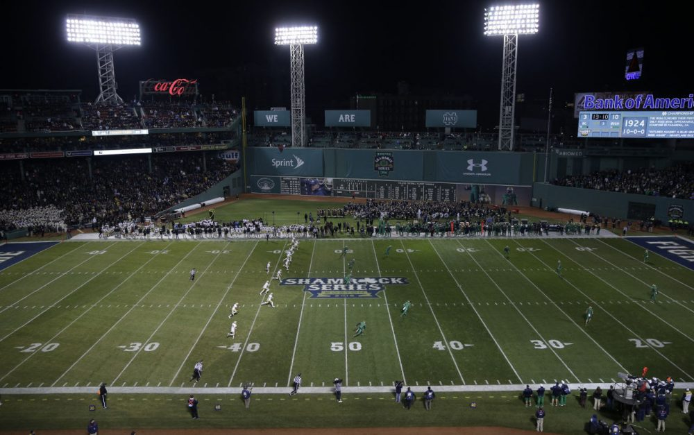 Boston College kicks the ball to Notre Dame during the third quarter of the Shamrock Series NCAA college football game at Fenway Park. (Charles Krupa/AP)