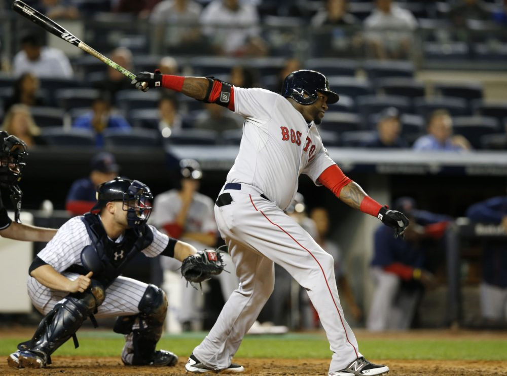 Boston Red Sox designated hitter David Ortiz hits a third-inning, RBI single in a baseball game against the New York Yankees in New York, Wednesday, Sept. 30, 2015.   (AP Photo/Kathy Willens)