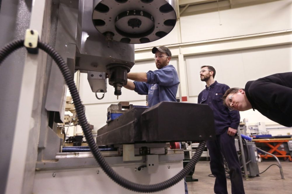 "Classes like ""Advanced precision machining"" prepare students for mill jobs straight out of vocational school. (Carlos Osorio/AP)"