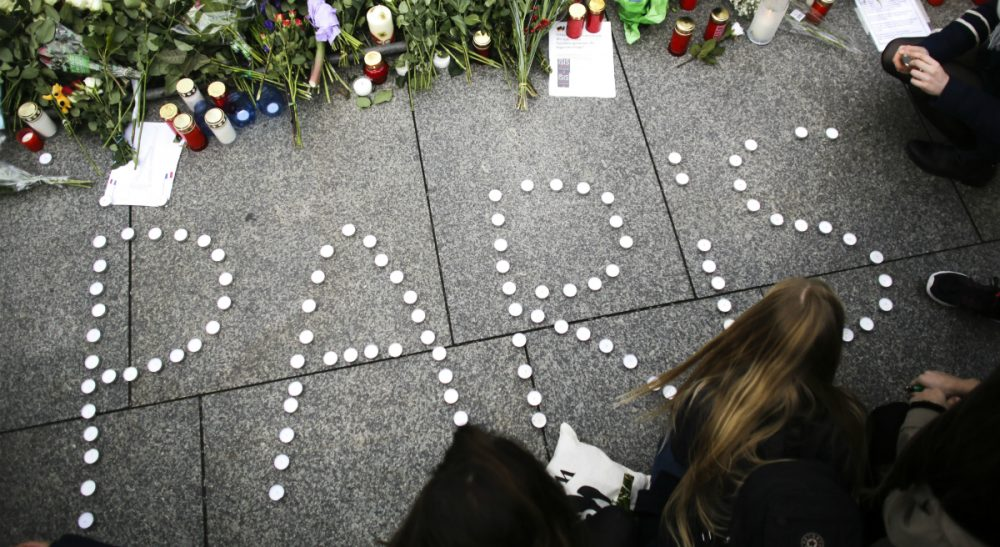 Young women have formed the word Paris with candles to mourn for the victims killed in Friday's attacks in Paris, France, in front of the French Embassy in Berlin, Saturday, Nov. 14, 2015. Multiple attacks across Paris on Friday night have left scores dead and hundreds injured. (Markus Schreiber/ AP)