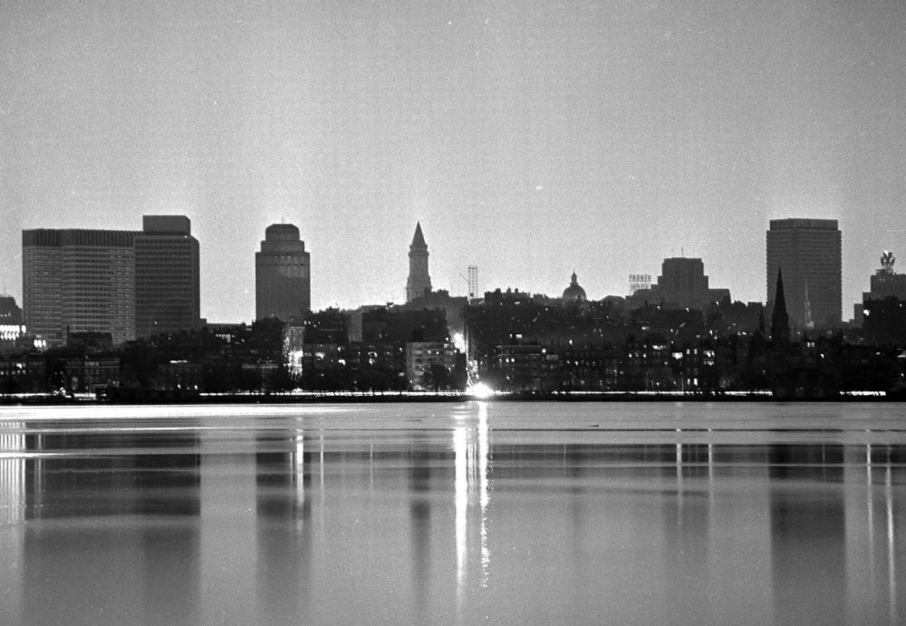 In this Nov. 9, 1965, file photo, the darkened Boston skyline is lit only by the full moon during a massive power failure that blacked out many sections of the Northeast and parts of Canada, 50 years ago. The two brightly lighted streets are on Beacon Hill, still lit by gaslight. (J. Walter Green/AP, File)