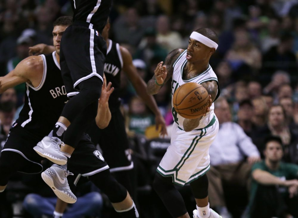 Boston Celtics guard Isaiah Thomas (4) passes  during Friday night's game in Boston. (Charles Krupa/AP)
