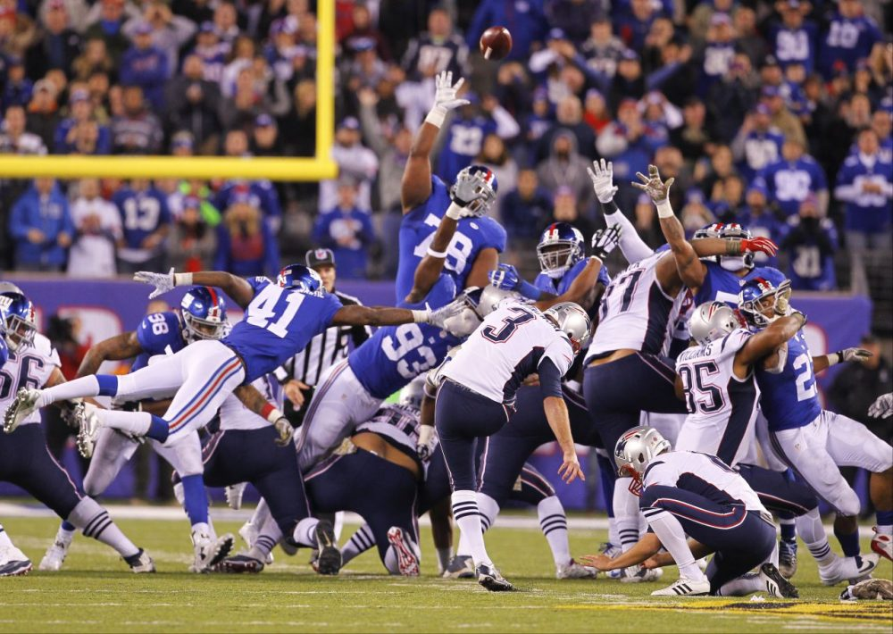 With one second remaining and the Patriots trailing by two points, kicker Stephen Gostkowski nailed a 54-yard field goal to give the Patriots a 27-26 win. (Gary Hershorn/AP)
