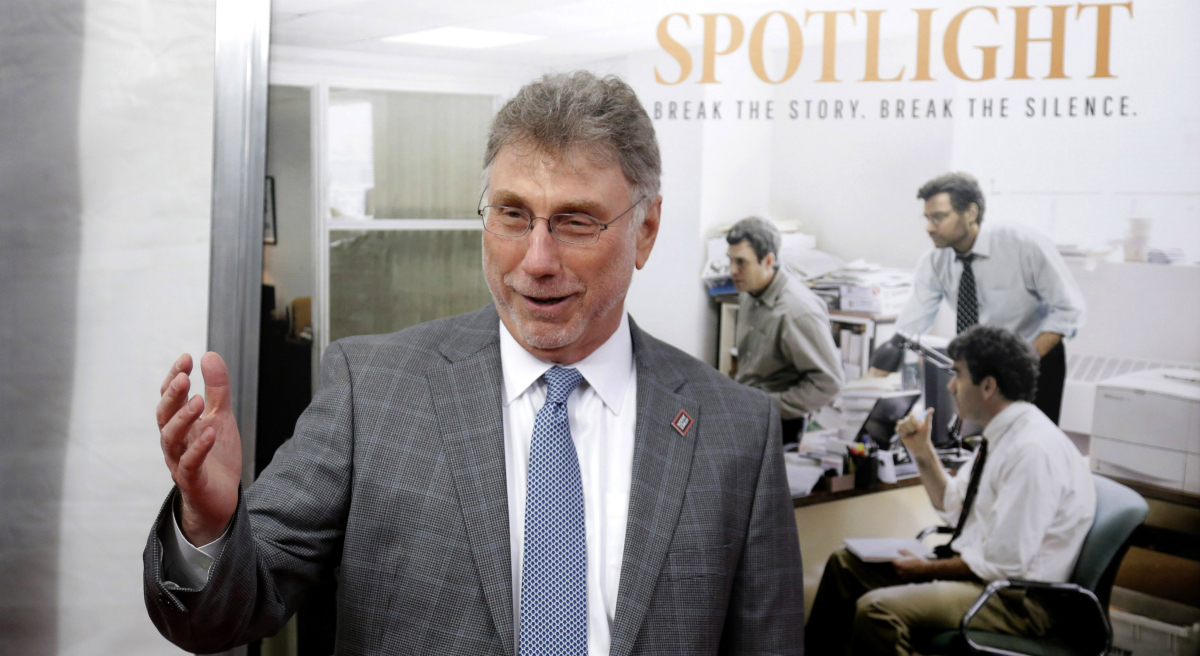 """Marty Baron: """"Many charitable nonprofits... get a pass on close examinations because they are seen as doing good. And many do good, but that shouldn't exempt them from accountability."""" Pictured: Baron, former editor of The Boston Globe, walks the red carpet as he attends the Boston-area premiere of the film """"Spotlight."""" (Steven Senne/AP)"""