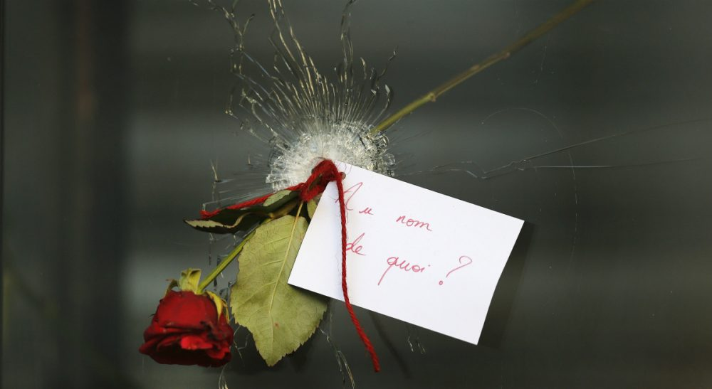 "John Tirman: ""France was the epicenter of the Enlightenment that fairly defines Western civilization. And the jihadis, in their reckless, apocalyptic pathology, detest above all such values."" Pictured: A message that reads: 'In the name of what?' and a rose is placed through a bullet hole in a window at the restaurant on Rue de Charonne, Paris, Sunday, Nov. 15, 2015, where attacks took place on Friday. (Frank Augstein/AP)"