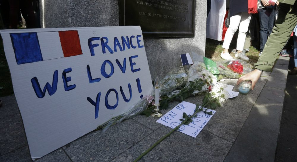A makeshift memorial for those killed or wounded in the Friday attacks in Paris, as seen at a vigil Sunday, Nov. 15, 2015, in Boston, held in sympathy for the people of Paris. The memorial rests at the foot of a statue of French Revolutionary War military officer Marquis de Lafayette on the Boston Common. (Steven Senne/AP)
