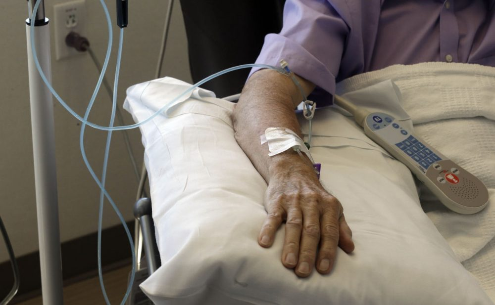 A new report from the Deprtment of Public Health and Massachusetts Cancer Registry looks at rates of cancer incidence and mortality in the Commonwealth. (AP Photo/Gerry Broome)