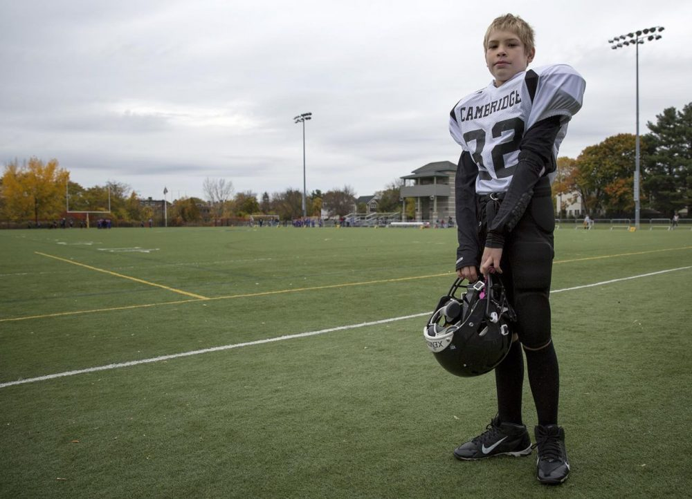 After some behavioral issues, Deven is now a client of the Cambridge Safety Net Collaborative. This summer, he was kept busy, including joining a Pop Warner football team. (Robin Lubbock/WBUR)
