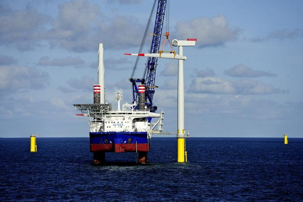 DONG Energy installs wind turbine blades in the German North Sea at the Borkum Riffgrund 1 power plant, which opened in October. The Danish company is proposing to build an offshore wind farm south of Martha's Vineyard. (Courtesy of DONG Energy)